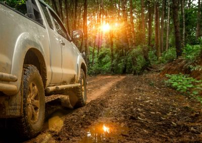 White 4WD in muddy bushland track at sunset   4x4 Obsession, 4WD Specialists