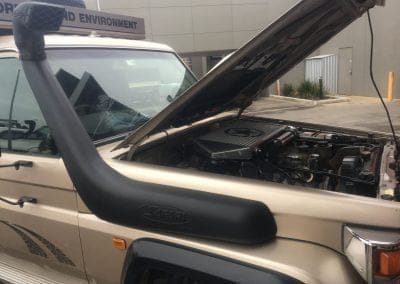 Chrome 4WD Landcruiser with snorkel parked outside 4x4 Obsession, Western Suburbs Melbourne