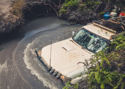 White 4WD in flood water, 4WD repairs and service required   4x4 Obsession