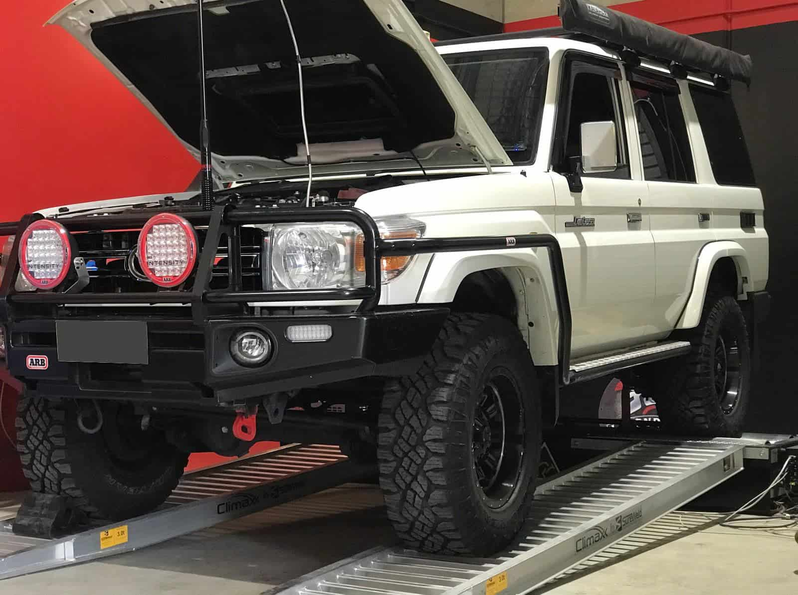 A 4WD Landcruiser on ramps ready for ECU Remapping | 4x4 Obsession