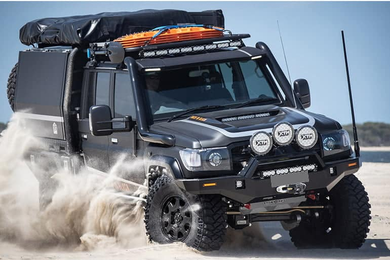 Geared up and rugged black 4x4 on beach after GVM Upgrades and added accessories | 4x4 Obsession